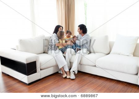 Animated Family Having Fun Sitting On Sofa