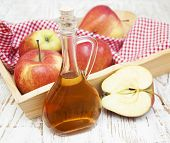 picture of cider apples  - Apple cider vinegar and fresh apple on a wooden background