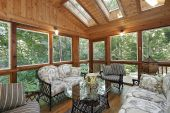 stock photo of screen-porch  - Wood paneled porch in suburban home with skylights - JPG