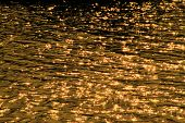 foto of flood-lights  - scintillate sunlight in the river background  - JPG