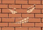 stock photo of faceless  - faceless grin on a red brick wall - JPG