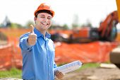 image of power-shovel  - Architect showing ok sign in a construction site - JPG