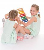 picture of montessori school  - Cute sisters work in the Montessori environment - JPG