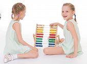 foto of montessori school  - Cute sisters work in the Montessori environment - JPG