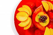 stock photo of cherry pie  - sweet cold red jelly pie with peach and nectarine - JPG