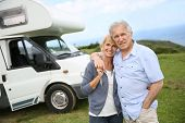 picture of motorhome  - Happy senior couple standing in front of camping car - JPG