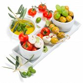 stock photo of cheese platter  - antipasti platter - fresh mozzarella cheese olives and cherry tomatoes isolated over white background