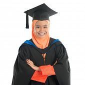 image of muslimah  - Portrait of smiling Asian female muslim student in graduate  - JPG