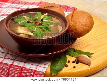 Chicken Broth Soup With Lavash, Garlic And Wheat Buns On The Cutting Board