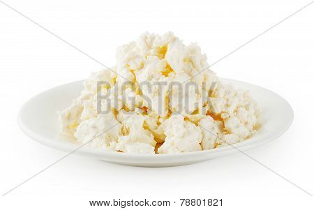 Fresh cottage cheese in round plate