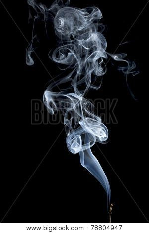 delicate smoke plume from a burning incense stick