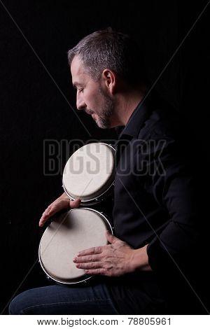 Bongo Player Isolated On Black