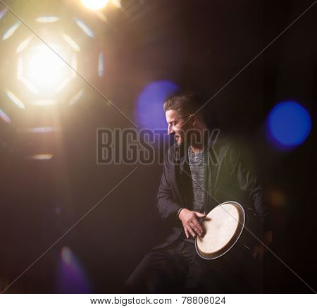 Musician Plays Bongo On A Stage