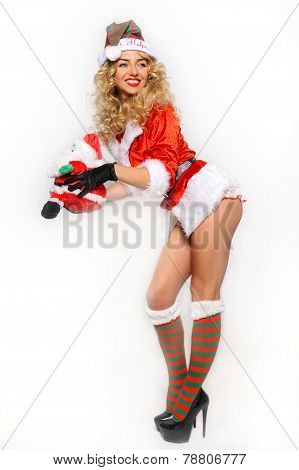 Sexy Santa Helper girl great image for creating Holiday Greeting postcard