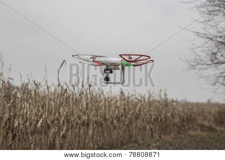 St.Louis Missouri. - DECEMBER19: Editorial photo of a DJI Phantom drone in flight with a mounted GoPro Hero3 Black Edition digital camera on December 19, 2014 in St.Louis Missouri over corn field