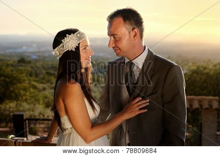 Bride And Groom Eye Contact At Sunset