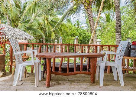 small outdoor cafe in tropical garden