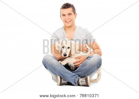 Man with his baby dog seated on floor isolated on white background