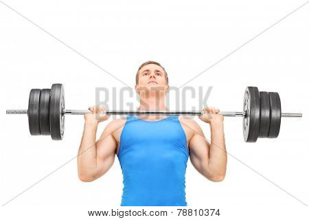 Young weightlifter training with a heavy barbell isolated on white background