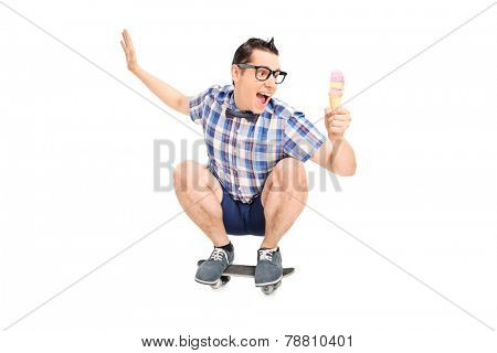 Young smiling male on a skate board with ice cream isolated on white background