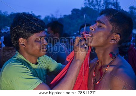 Tongue piercing in Gajan festival