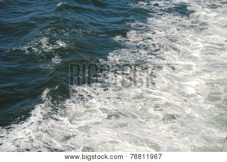 White Froth Foam On Sea Water