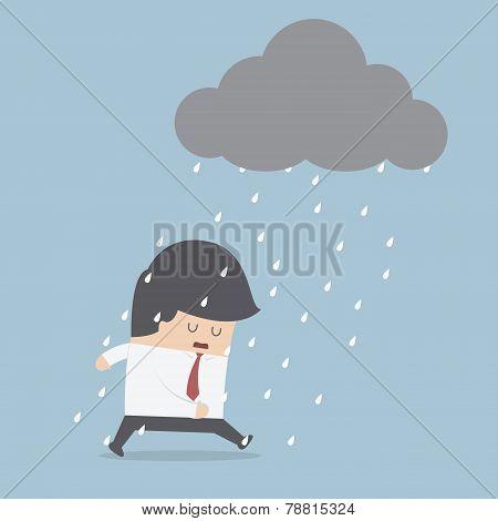 Depressed Businessman Walking In The Rain