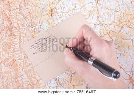Female Hand Writing A Post Card