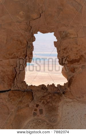 Dead Sea landscape seen through jagged window