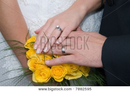 Married Couple Hands With Bouquet of Yellow Roses