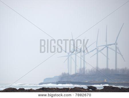 Windmills In Winter Mist