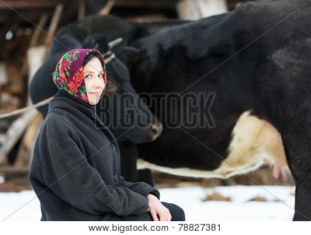 smiling country girl with a cow