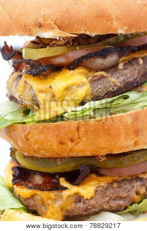 Macro of greasy double cheese burger tower.