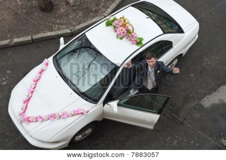 Groom Receive Bride With Open Near A White Wedding Car. Top View