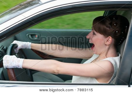 Woman In White Dress And White-gloved Driving A Car And Screaming. Looking Forvard