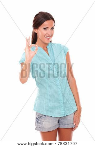 Hispanic Girl In Blue Blouse Gesturing A Great Job