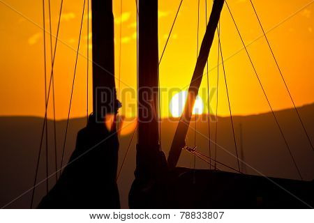 Golden Sunset And Sailboats