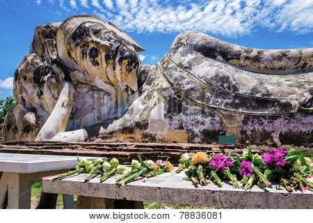 Flowers offered to the reclining Buddha of Wat Lokaya Sutha, Thailand