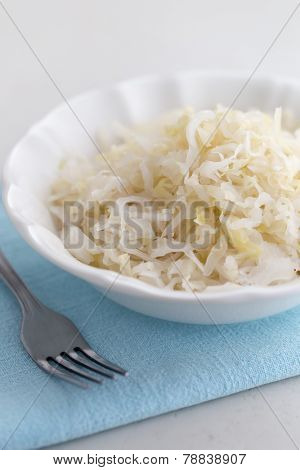 Sauerkraut in bowl with fork