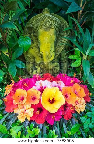 Ganesh statue with hibiscus flowers, Thailand