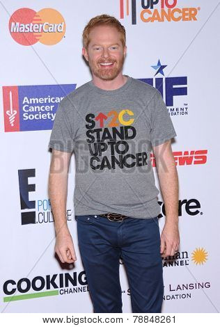 LOS ANGELES - SEP 05:  Jesse Tyler Ferguson arrives to the Stand Up To Cancer 2014  on September 05, 2014 in Hollywood, CA