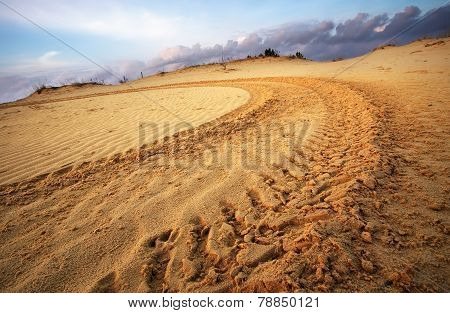 Motocross And Auto Sport Track On Blue Sky Background. Wheel Tracks On Sand