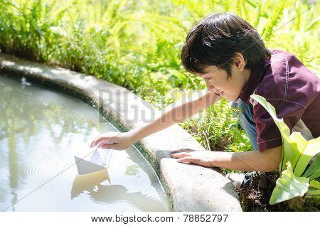 Little Boy Floating Paper Boat