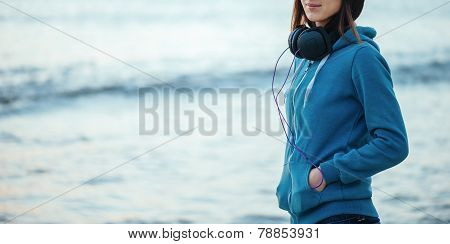 Girl With Headphones On Background Of Sea