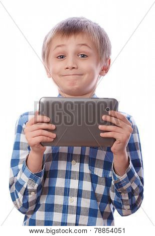 Boy with tablet, 8 years old, isolated on a white background