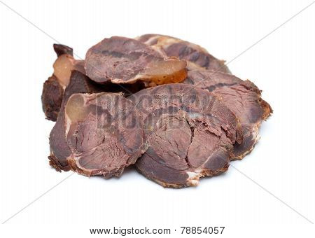 Roast beef on cutting board isolated on white background