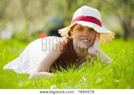 Girl In Hat Lying On Meadow