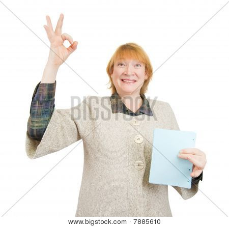 Happy Senior Woman Holding Empty Blue Poster