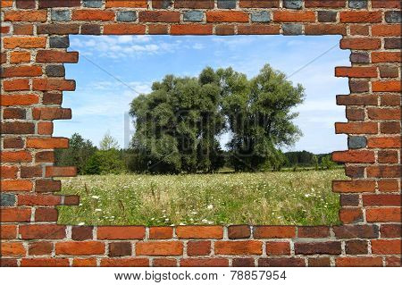 Broken Brick Wall And View To Summer Landscape