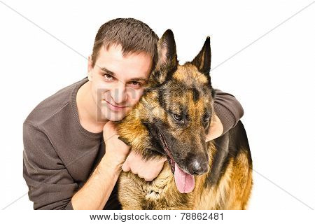 Man hugging a German Shepherd